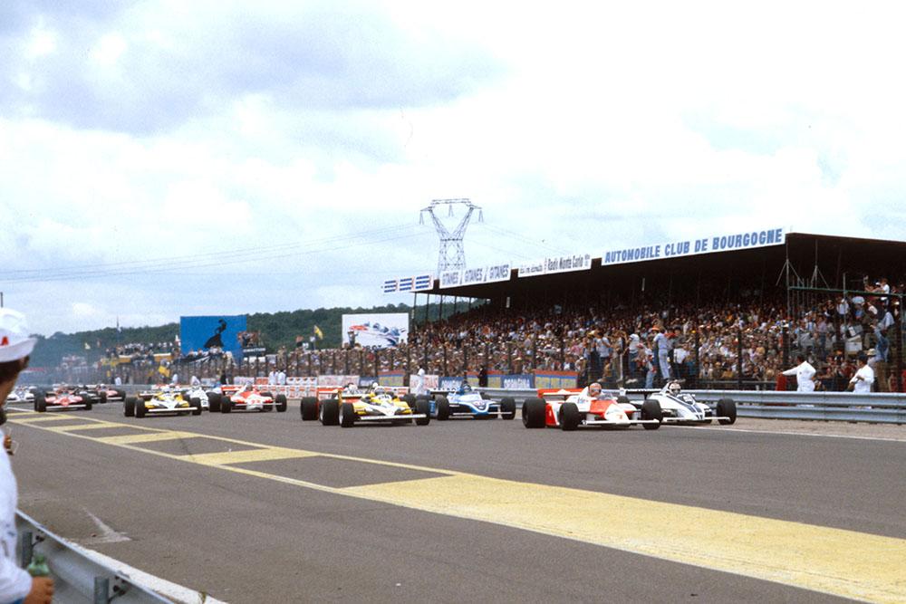 John Watson (McLaren MP4/1 Ford) leads Nelson Piquet (Brabham BT49C Ford), Alain Prost (Renault RE30) and Jacques Laffite (Ligier JS17 Matra) at the start.