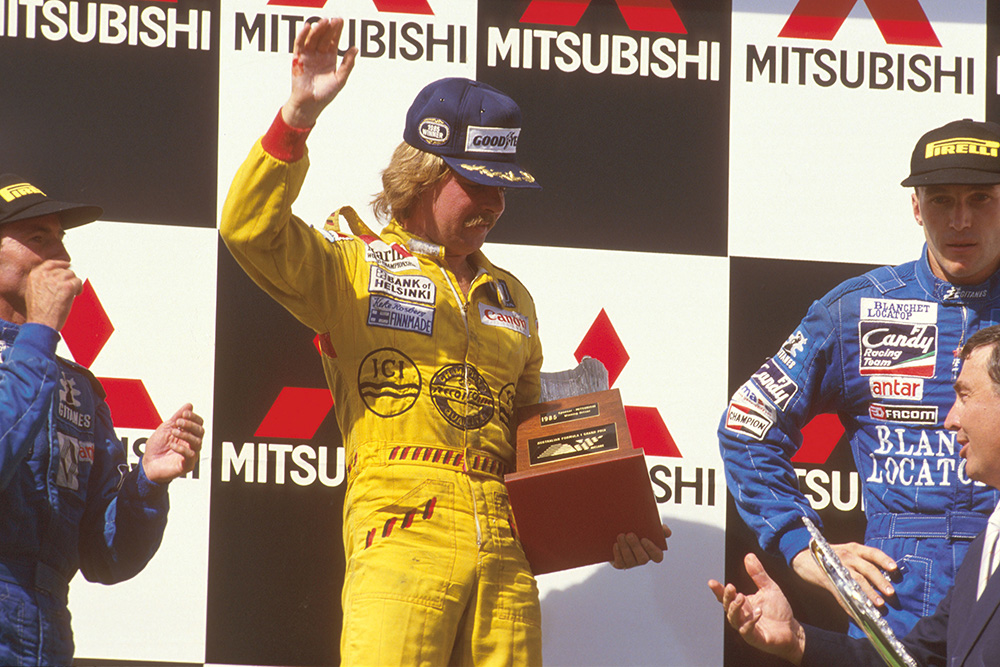 Keke Rosberg, 1st position, Jacques Laffite, 2nd position and Philippe Streiff, 3rd position on the podium.