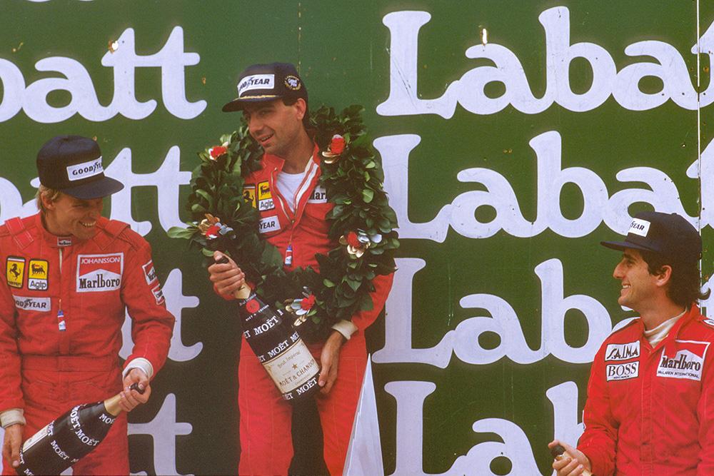 Michele Alboreto, 1st position, Stefan Johansson, 2nd position and Alain Prost, 3rd position, on the podium.