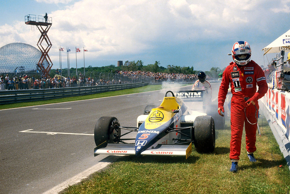 Nigel Mansell walks from his Williams FW10 during Saturday qualifying when he suffered a problem with a Honda turbo.