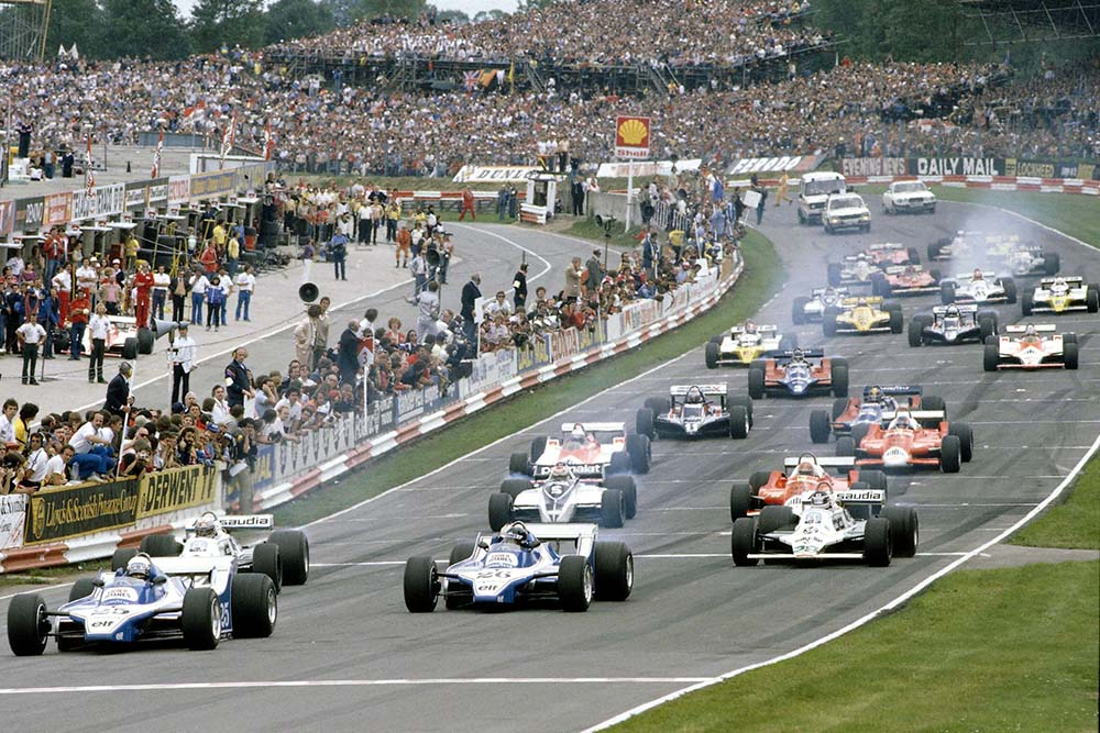 Didier Pironi leads team mate Jacques Lafitte (Both Ligier JS11/15 Ford's), Alan Jones, Carlos Reutemann (Both Williams FW07B's), Nelson Piquet (Brabham BT49 Ford) and Bruno Giacomelli (Alfa Romeo 179) at the start.