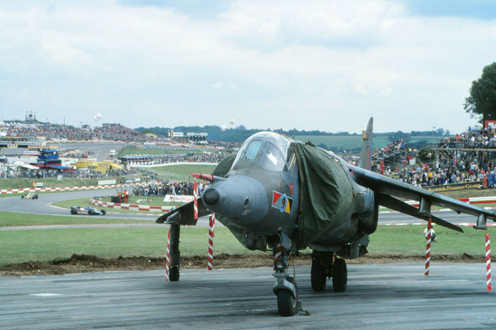 The  RAF Harrier of Flt. Lt. Dudley Carvell parked on the inside of Clearways corner after wowing the crowd during a pre-race display.