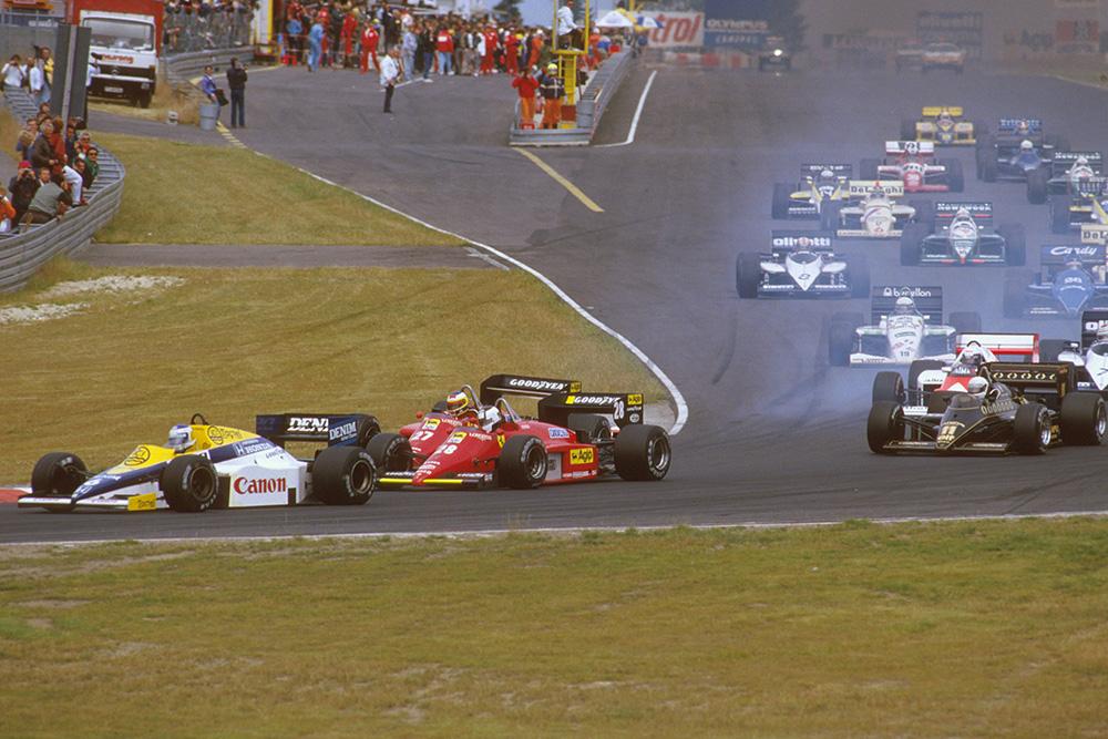 Keke Rosberg (Williams FW10 Honda) leads Stefan Johansson and Michele Alboreto (both Ferrari 156/85's) at the start. Senna has already gone through the shot.