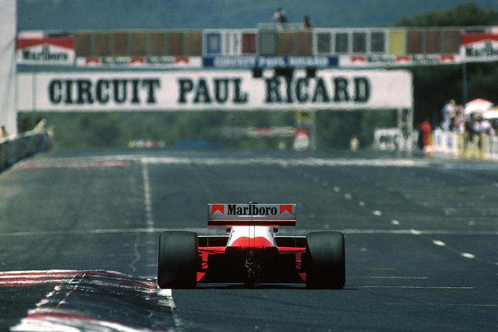 A McLaren heads down the start straight.