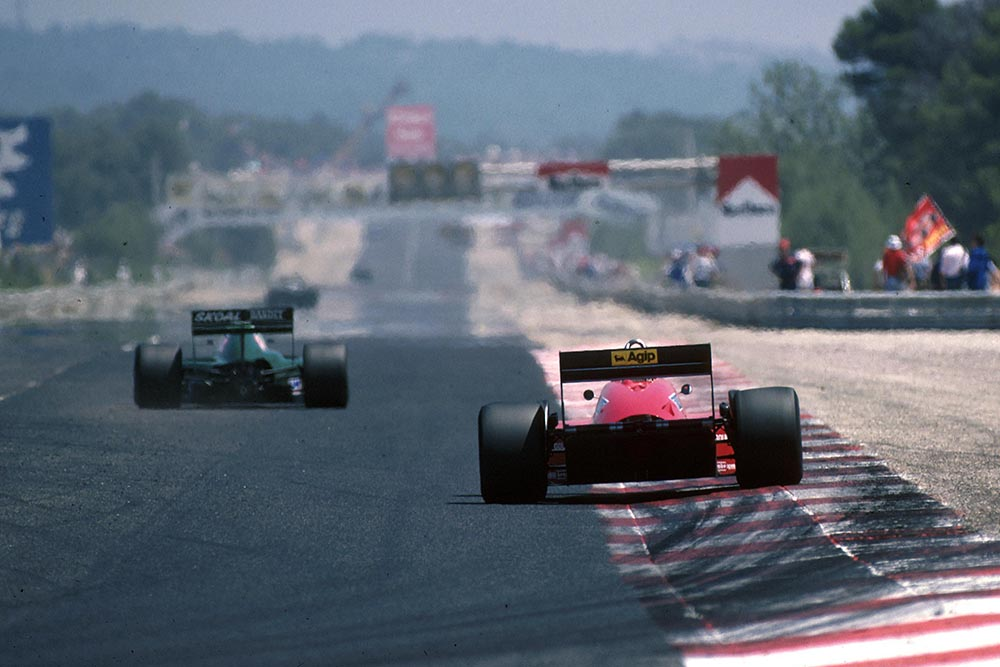 The cars head down the main straight.
