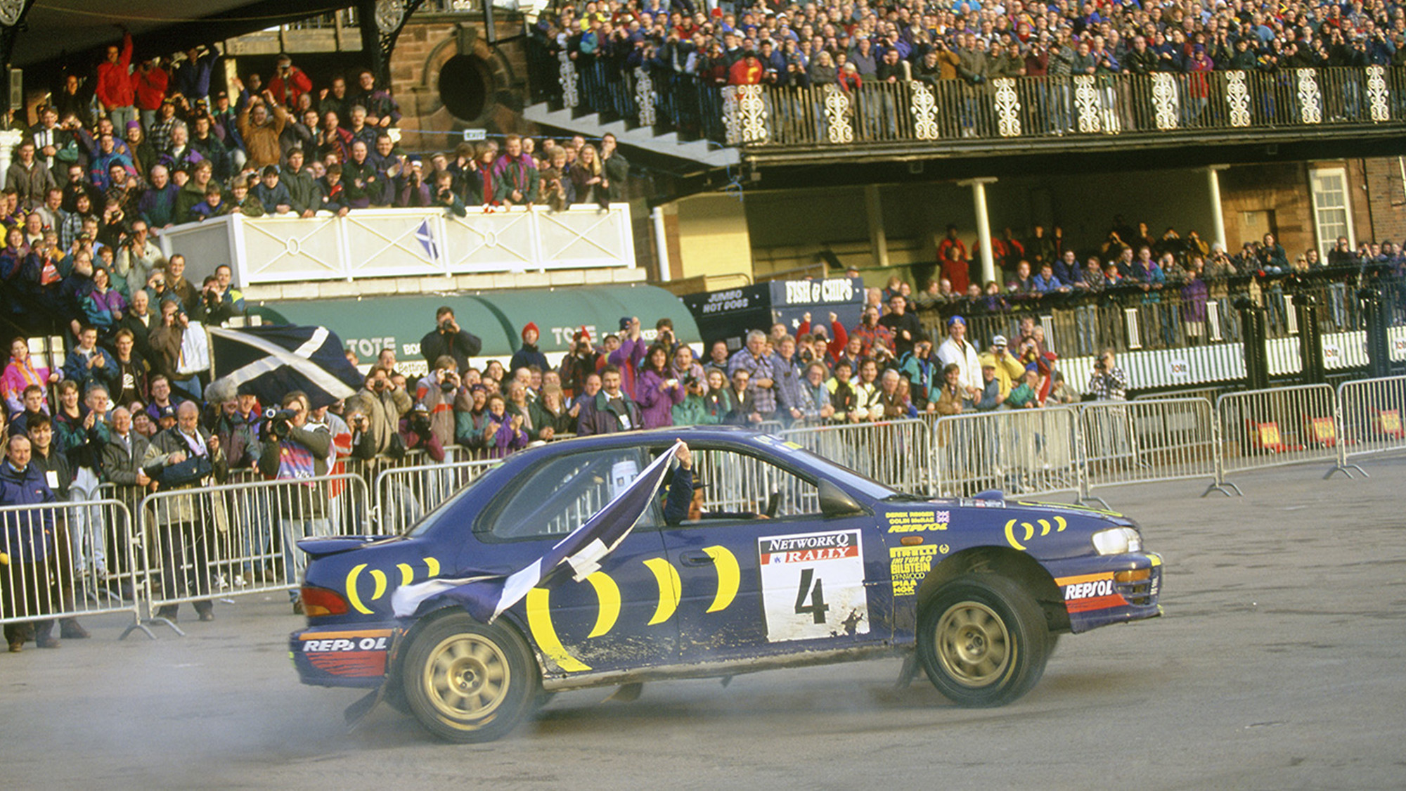Colin McRae parades in front of the Chester Racecourse crowd after winning the 1995 RAC Rally