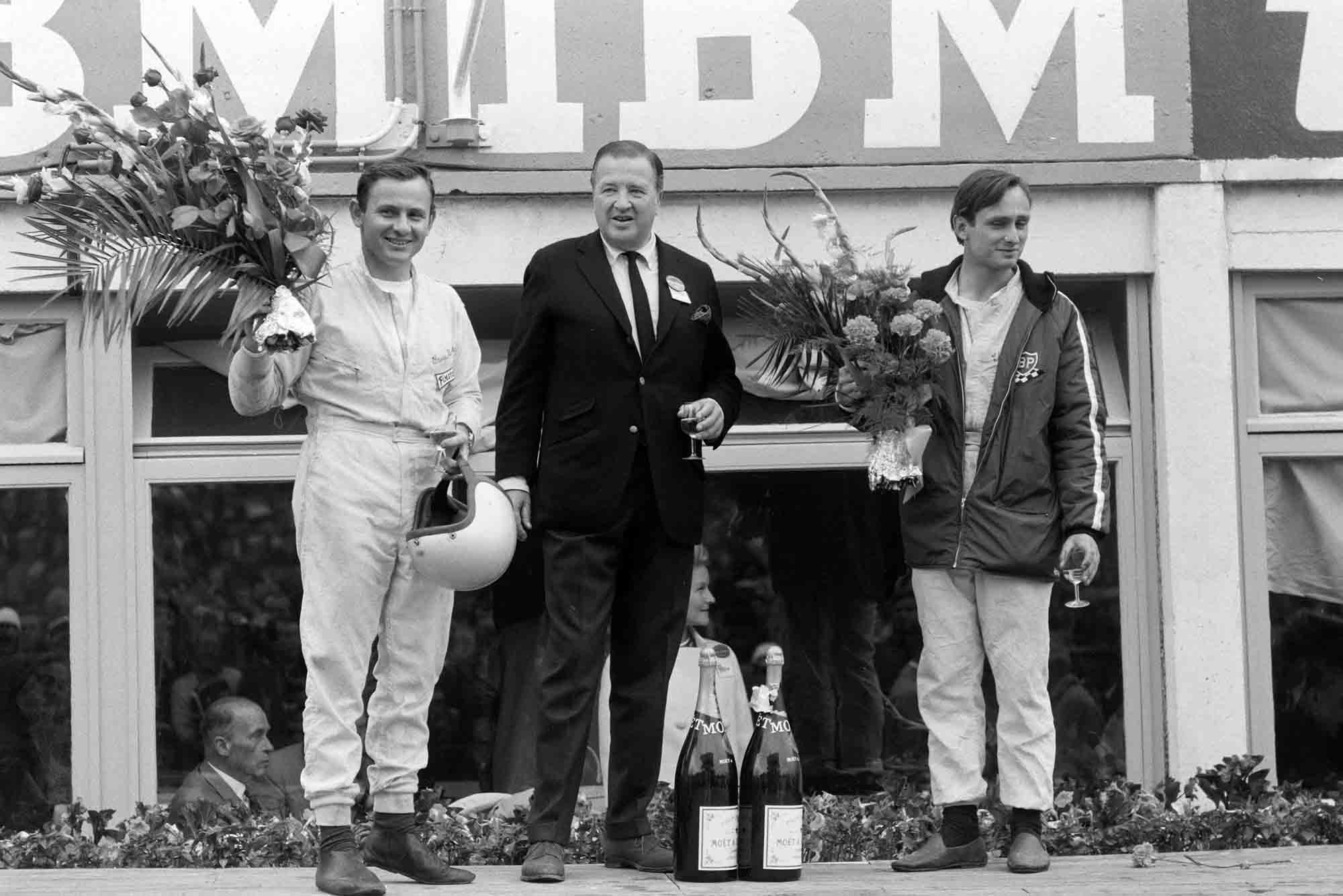 Henry Ford on the podium with his winning Gt40 MkII drivers Bruce McLaren and Chris Amon