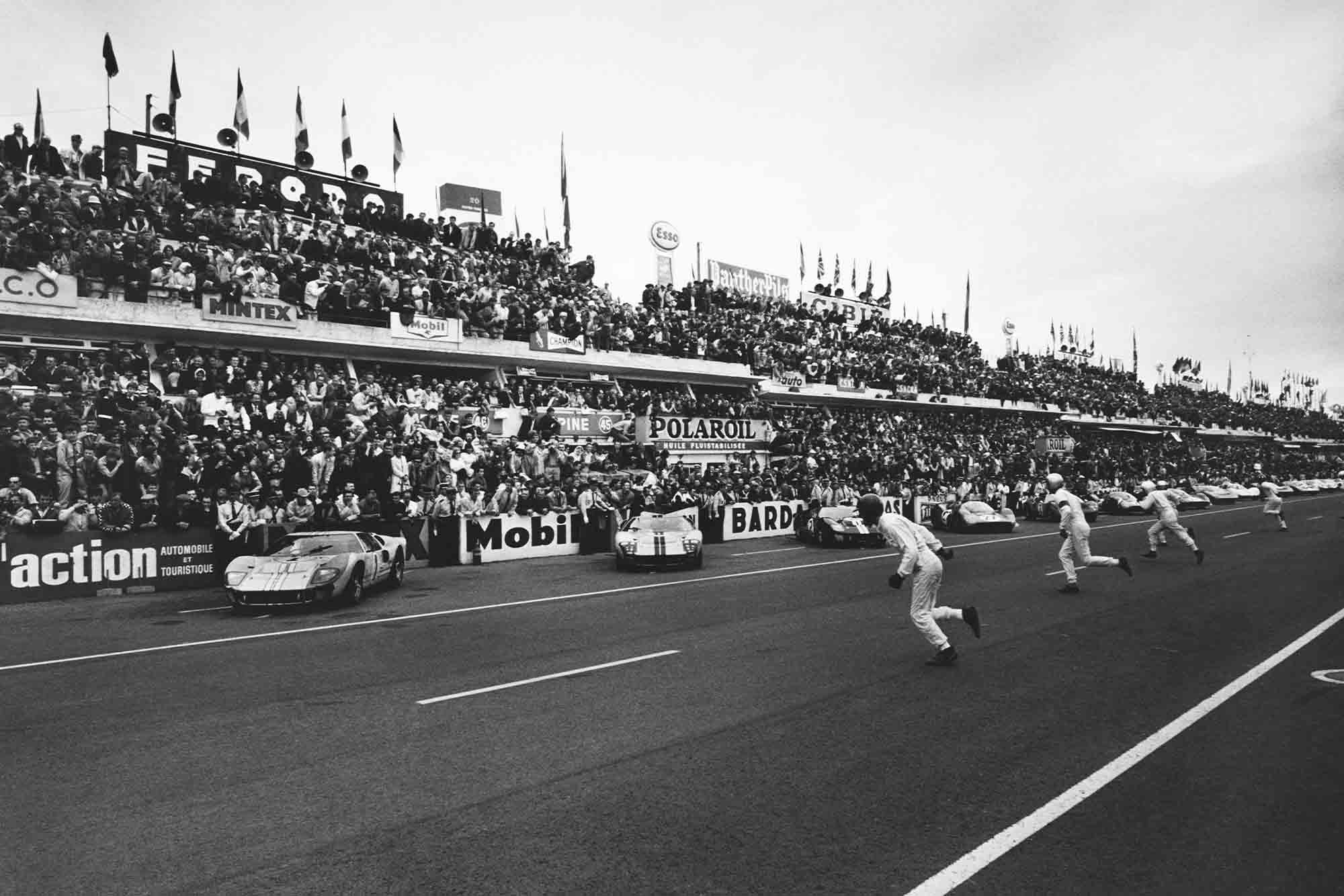 Drivers run to their cars at the start of Le Mans 1966