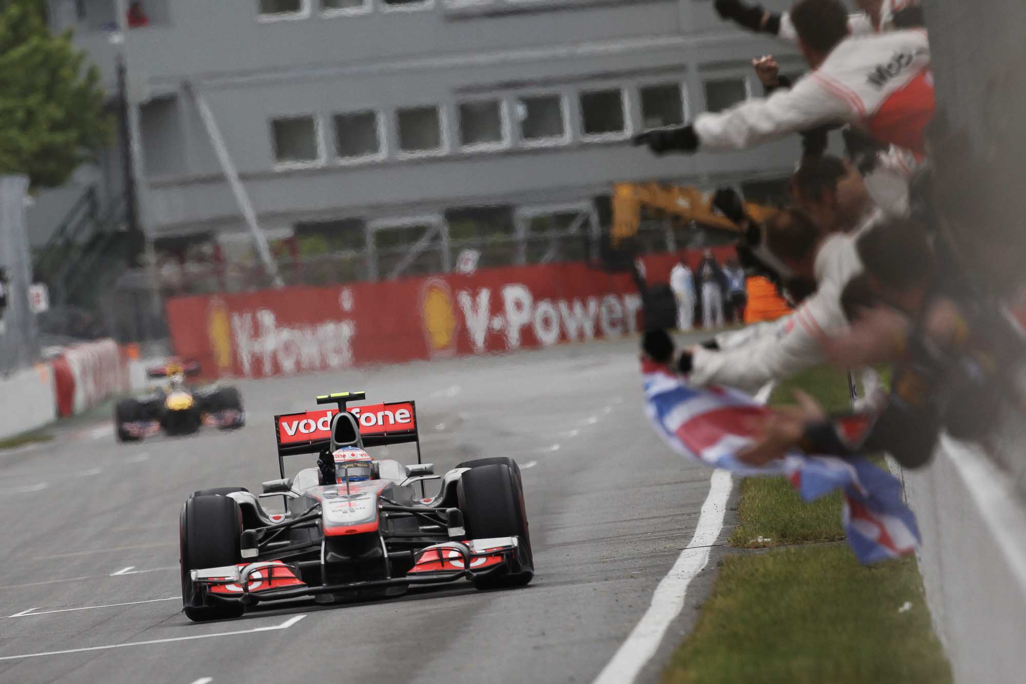 Jenson Button takes the chequered flag to win 2010 Canadian Grand Prix Montreal