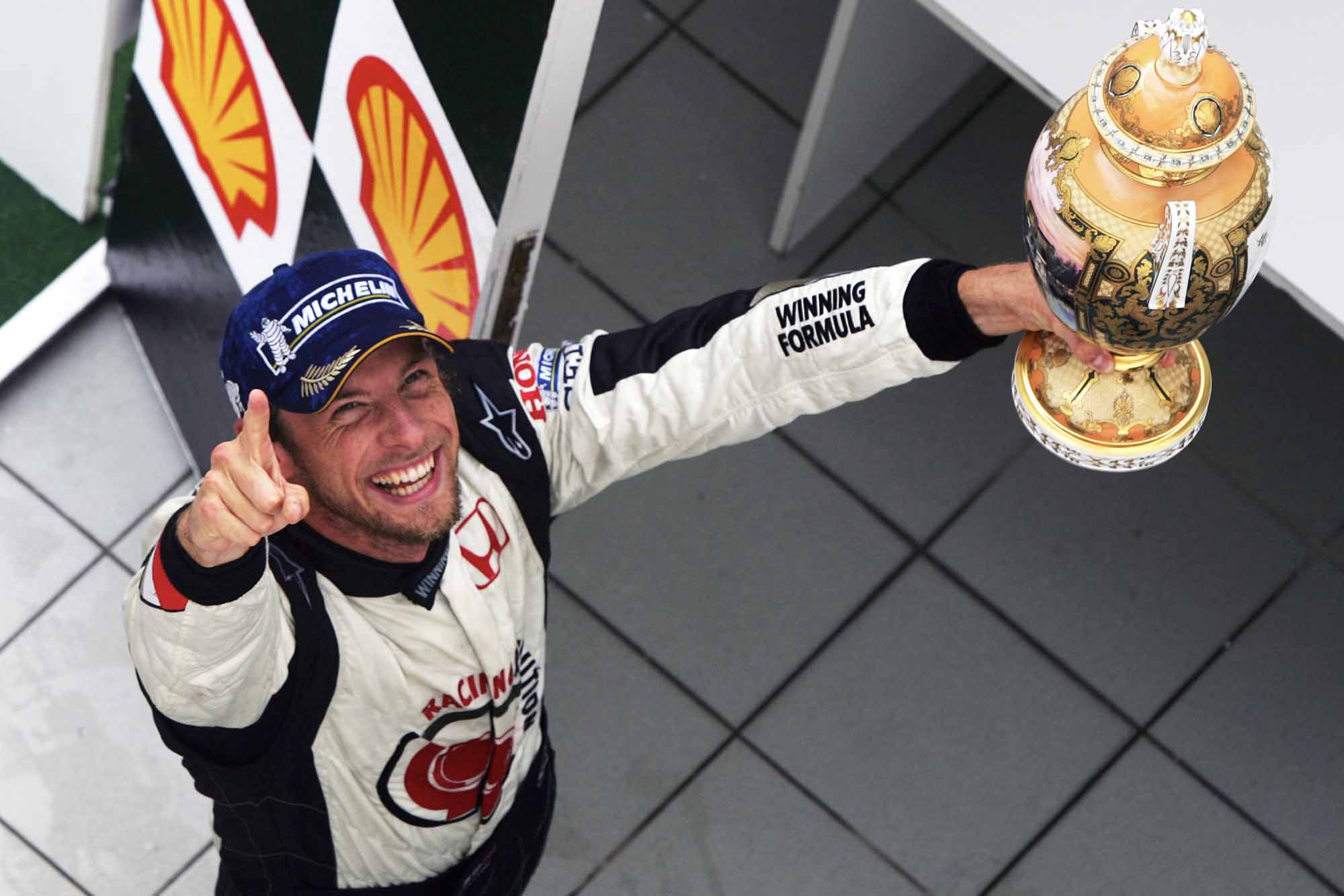 Jenson Button jubilantly holds his trophy aloft after winning 2006 Hungarian Grand Prix