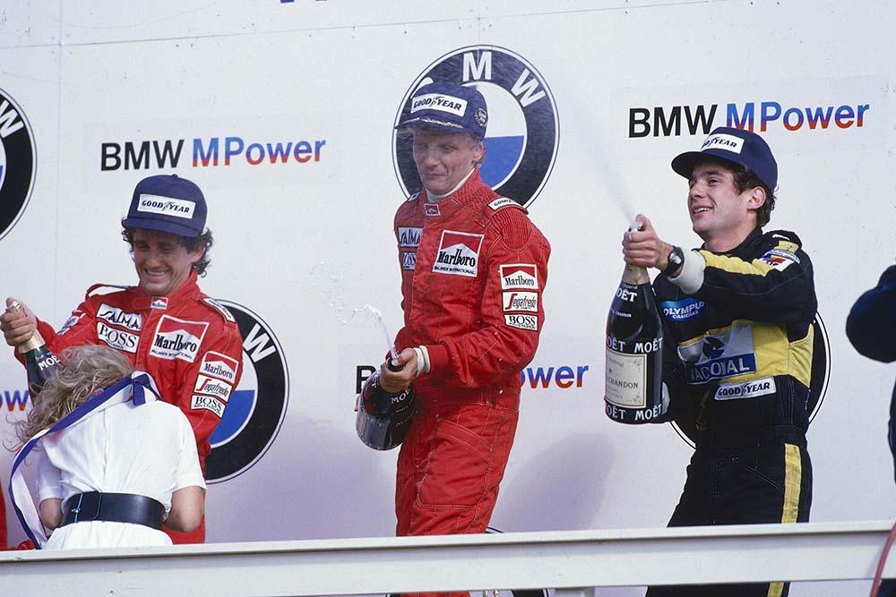 Niki Lauda, 1st position, Alain Prost, 2nd position and Ayrton Senna 3rd position on the podium.