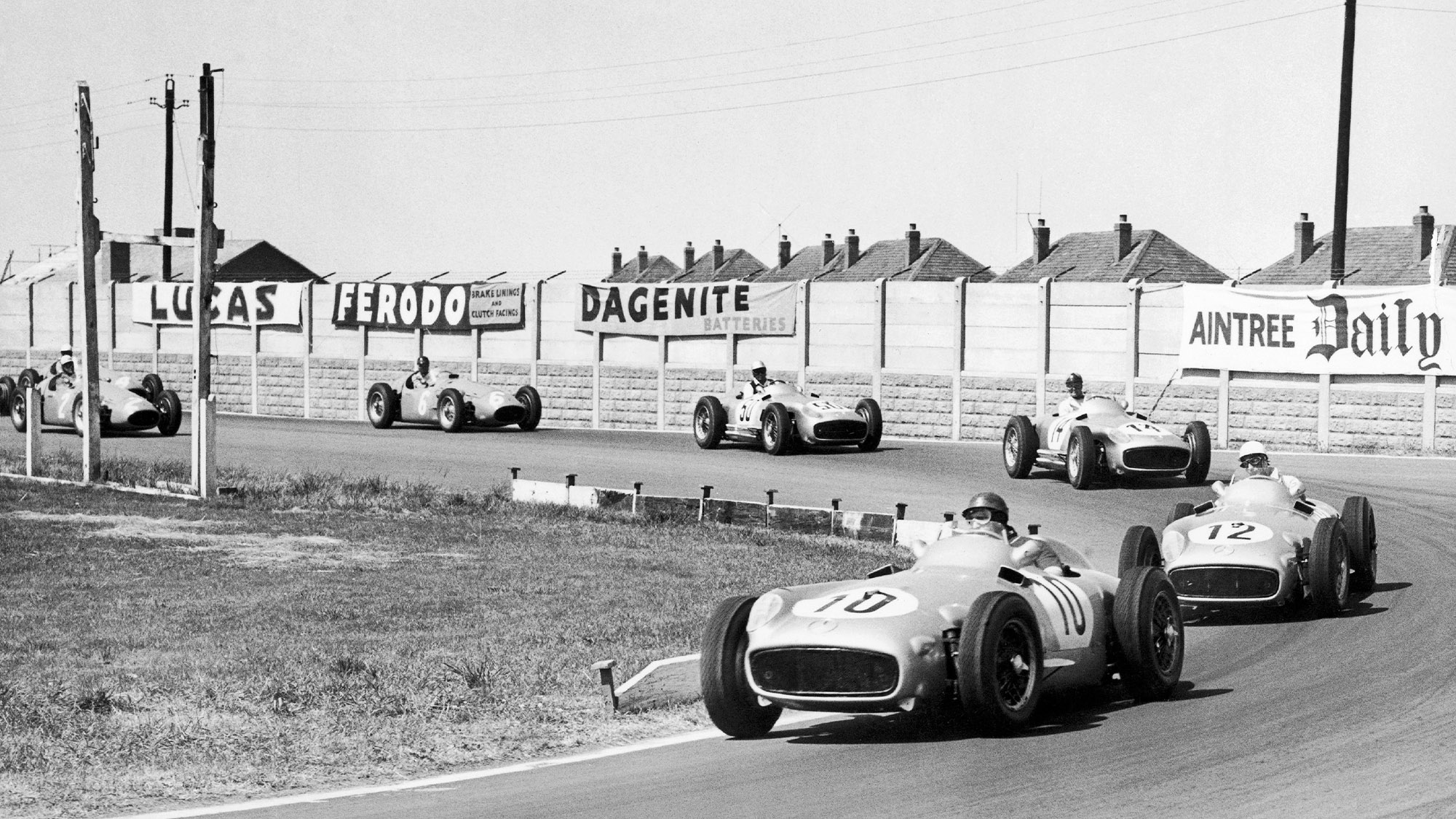Juan Manuel Fangio leads at Aintree in the early laps of the 1955 F1 British Grand Prix