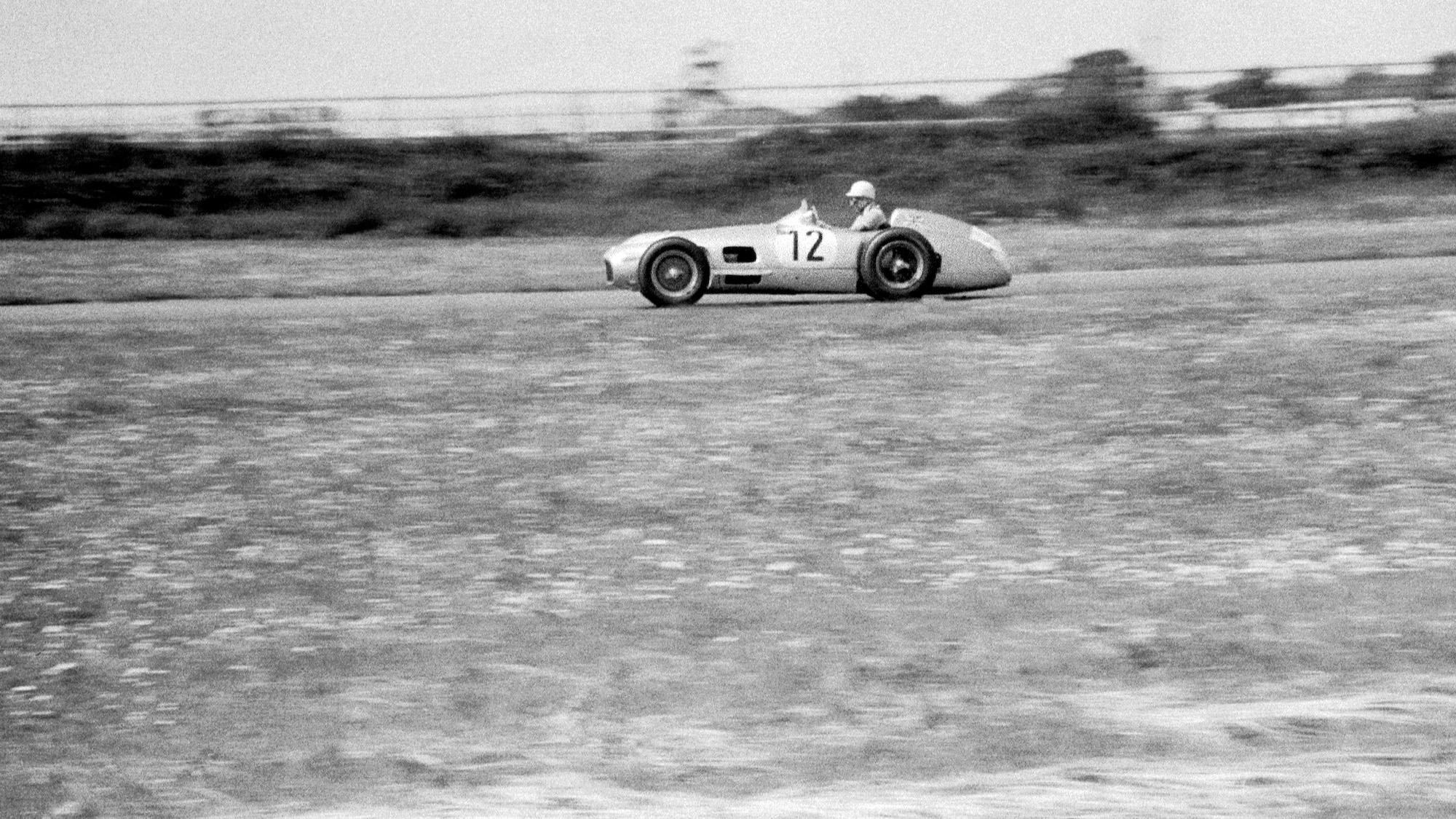 Side view of Stirling Moss during the 1955 F1 British Grand Prix at Aintree