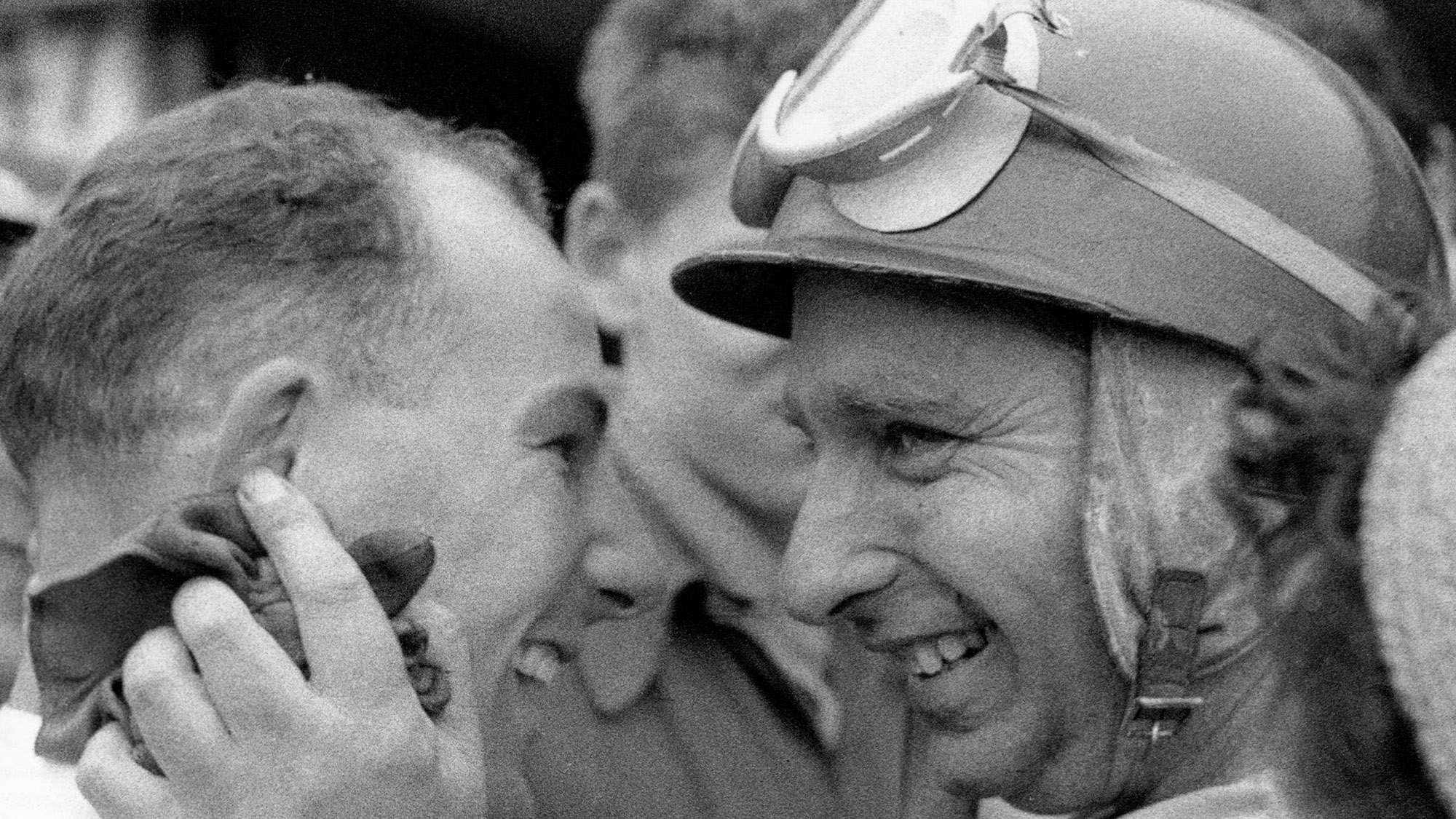 Stirling Moss and Juan Manuel Fangio smile after their 1-2 finish at the 1955 British Grand Prix at Aintree