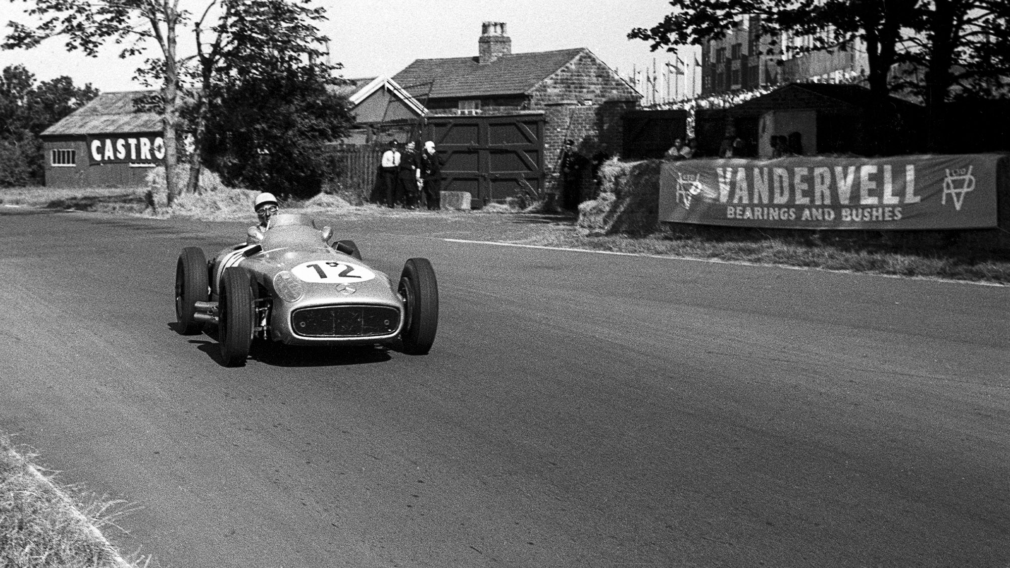 Stirling Moss in his Mercedes W196 R during the 1955 British Grand Prix at Aintree