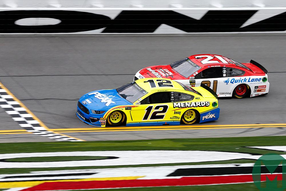 Ryan Blaney and Paul Menard, both in Mustangs, race at Daytona in 2019