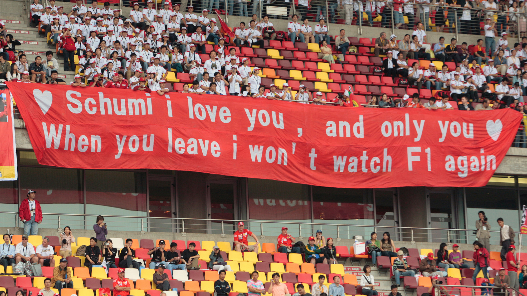 Fans at the 2006 F1 Chinese Grand Prix hold a banner marking Michael Schumacher's retirement form the sport