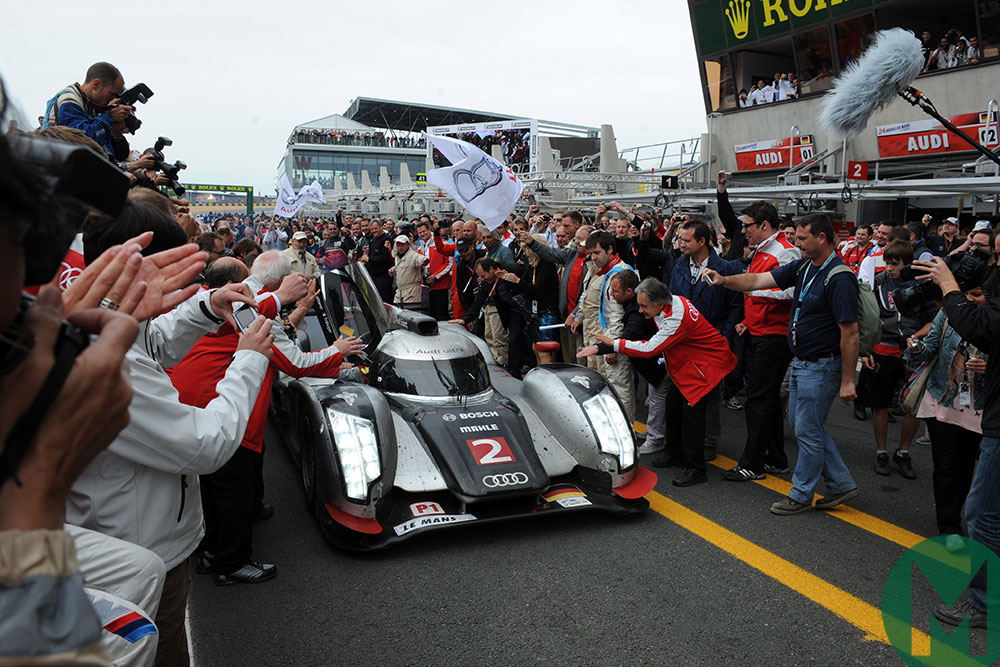 The no2 Audi takes the applause after a dramatic 2011 Le Mans victory
