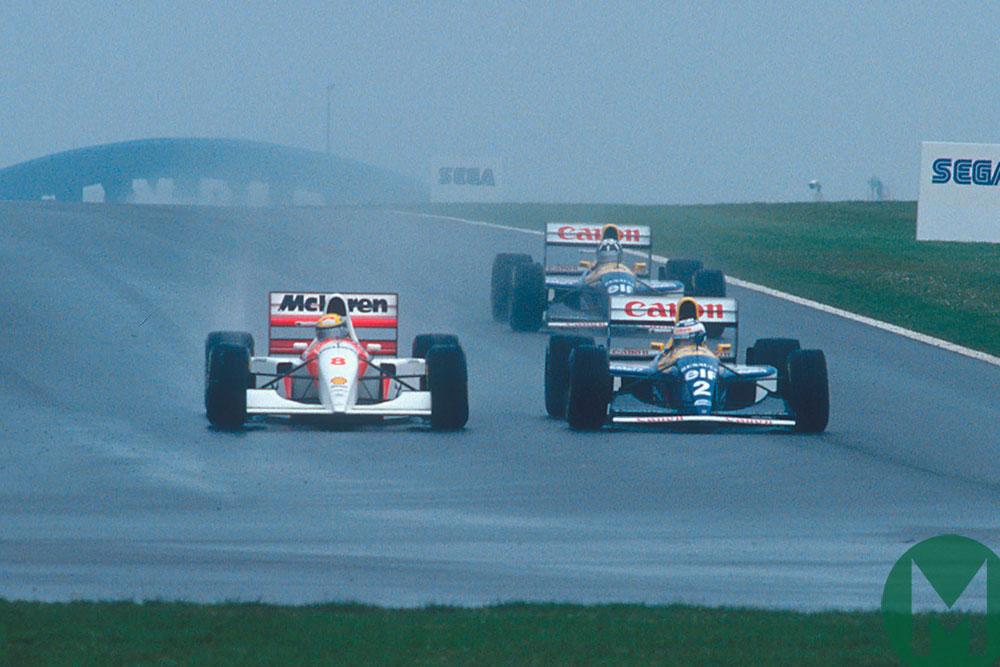 Ayrton Senna McLaren passes Alain Prost Williams to lead the 1993 European Grand Prix