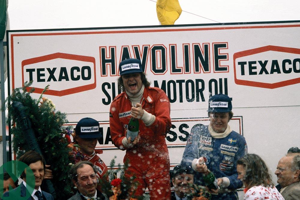 Gunnar Nilsson spraying champagne at the 1977 Belgian Grand Prix