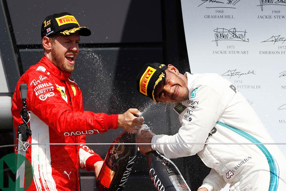 Lewis Hamilton and Sebastian Vettel spray champagne at the 2018 British Grand Prix