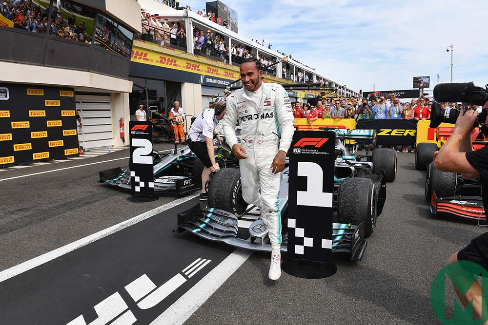 Lewis Hamilton steps from his car after winning the 2019 French Grand Prix