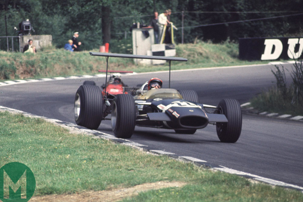 Jo Siffert in the Rob Walker entered Lotus 49B leads Chris Amon's Ferrari in the 1968 British Grand Prix