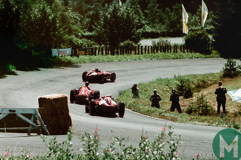 Fangio splits the Ferrari pair of Mike Hawthorn and Peter Collins