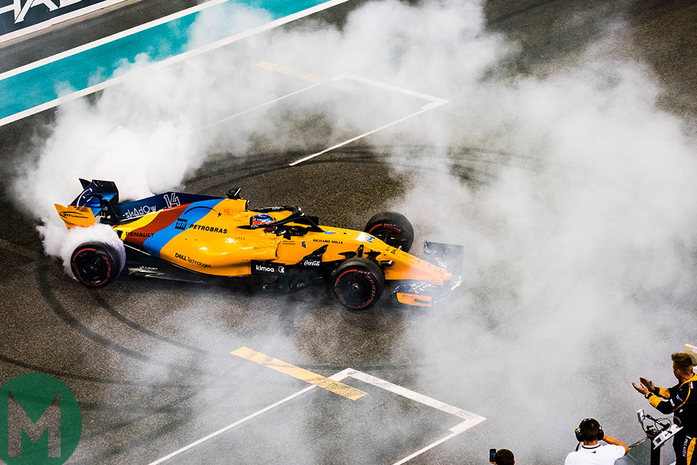 Fernando Alonso in a cloud of tyre smoke at his final grand prix at Abu Dhabi in 2018