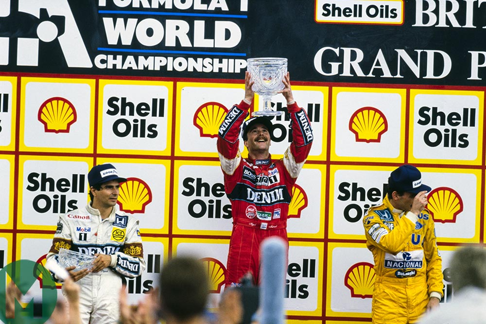 Nigel Mansell on the top step of the podium at the 1987 British Grand Prix