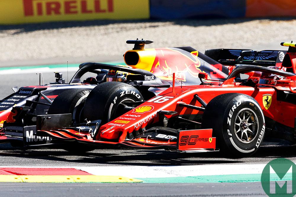 Max Verstappen's Red Bull passes Charles Leclerc's Ferrari late in the 2019 Austrian Grand Prix