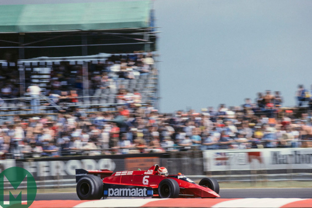 Nelson Piquet in the Brabham-Alfa Romeo speeds past the crowds at Silverstone