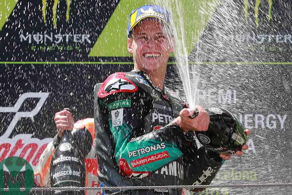 Fabio Quartararo celebrates on the podium