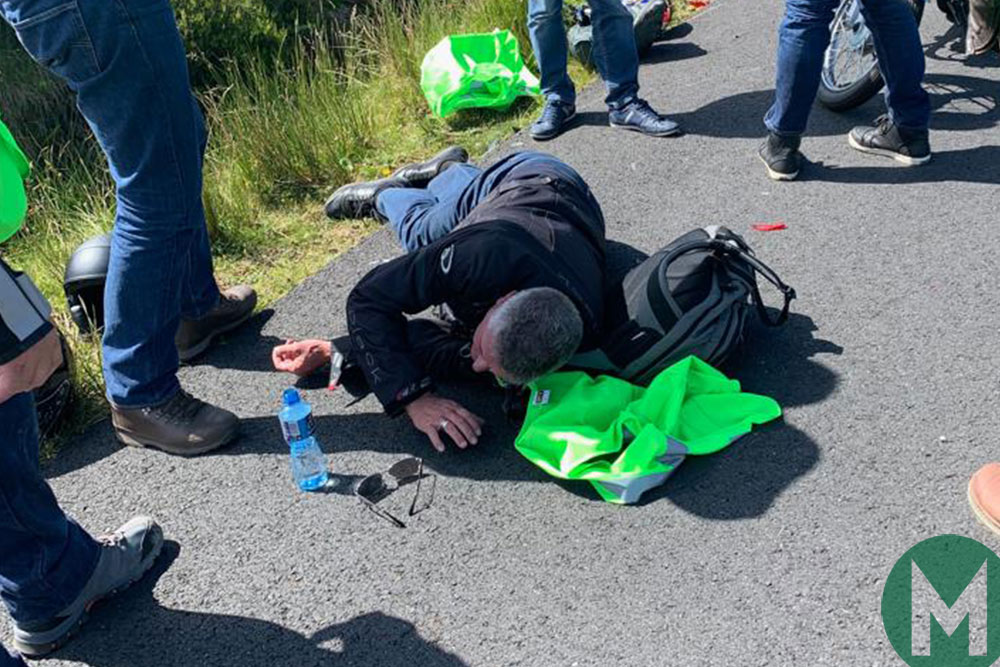 Donnelly lies on the ground after his motorbike accident