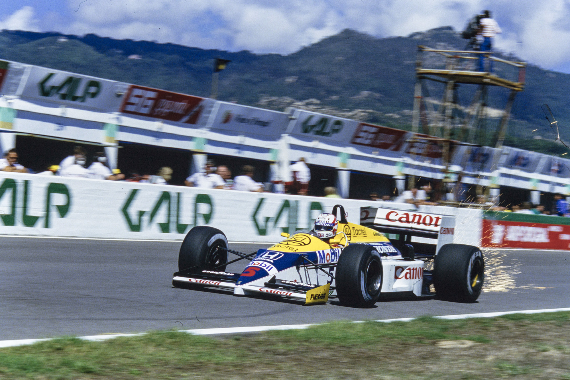 Sparks fly from Nigel Mansell's Williams in the 1986 Portuguese Grand Prix