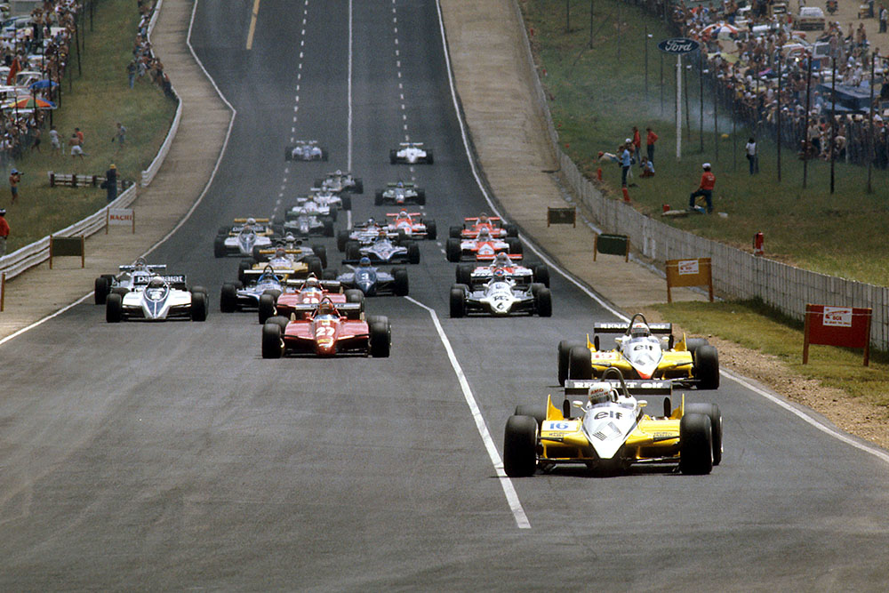 Rene Arnoux and teammate Alain Prost (both Renault RE30B's) lead the rest of the field at the start.