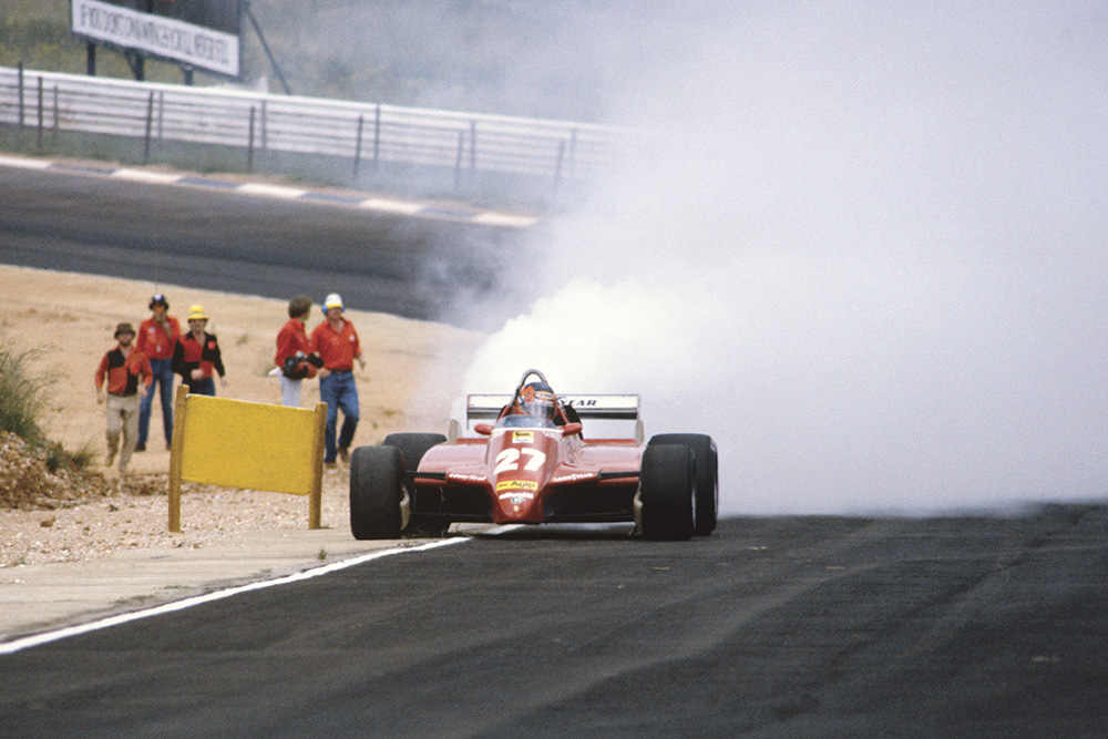 Gilles Villeneuve exits the race with a blown turbo in his Ferrari 126C2.