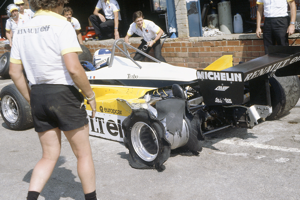 Alain Prost's Renault RE30B in the pits with a puncture.