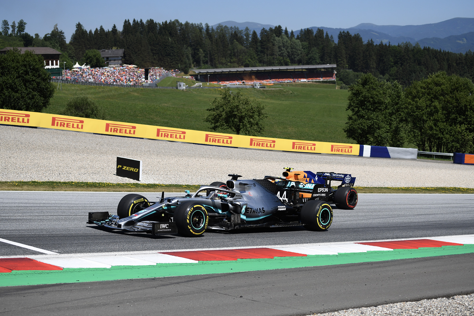Lando Norris tries to pass Lewis Hamilton on this inside at the 2019 Austrian Grand Prix