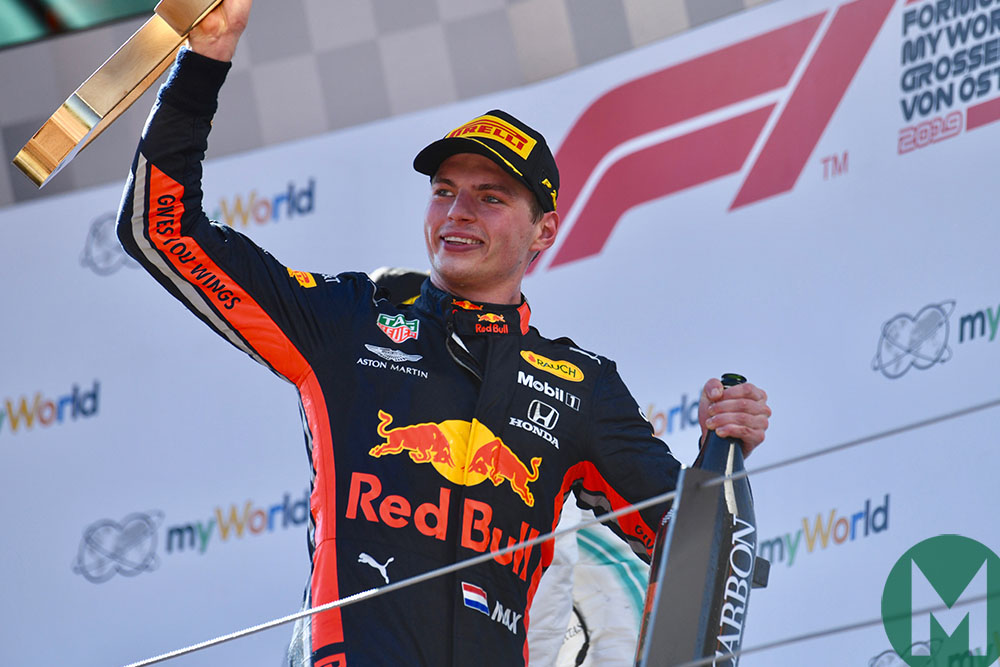 2019 Austrian Grand Prix winner Max Verstappen with trophy and champagne on the podium