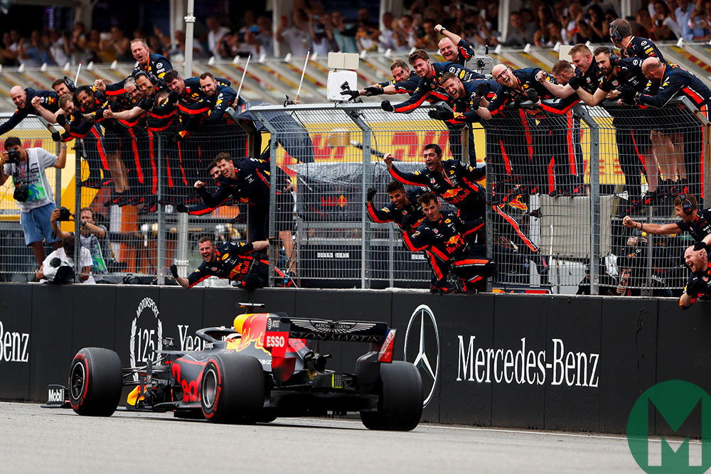 Max Verstappen is cheered by his Red Bull team as he wins the 2019 German Grand Prix