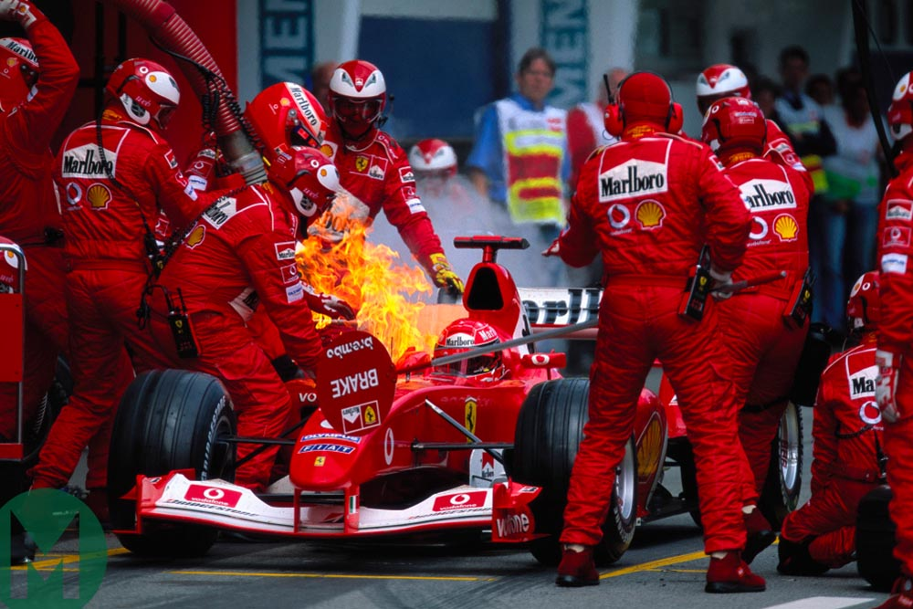 Michael Schumacher in the Ferrari as a fire breaks out during a pit stop at the 2003 Austrian Grand Prix