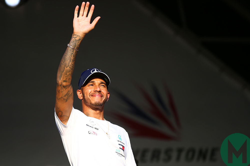Lewis Hamilton waves at the crowd in the 2018 British Grand Prix at Silverstone