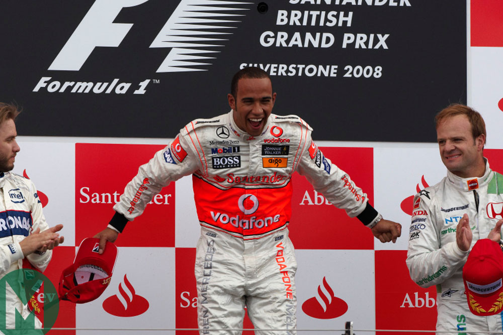 Lewis Hamilton on the podium after winning the 2008 British Grand Prix at Silverstone