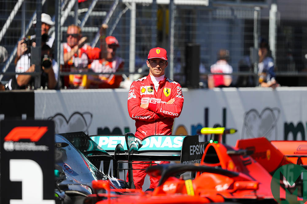 Charles Leclerc watches his car parked in the No1 spot after he qualified on pole for the 2019 Austrian Grand Prix