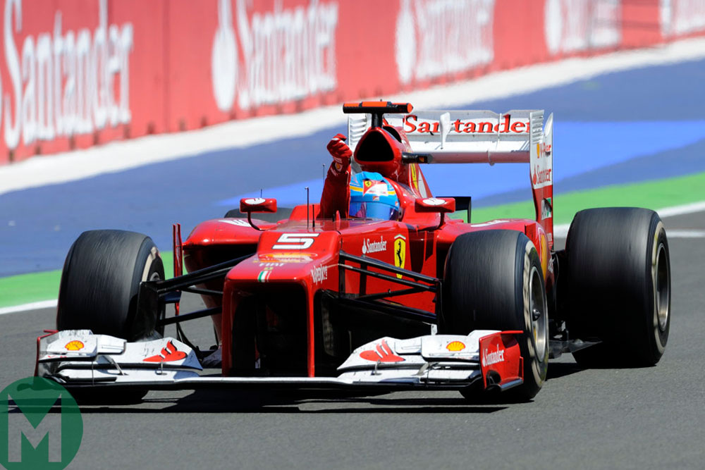 Fernando Alonso celebrates victory in the 2012 European Grand Prix at Valencia