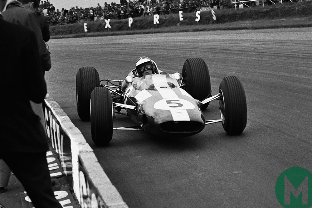 Jim Clark negotiates a turn in his Lotus-Climax in the 1965 British Grand Prix