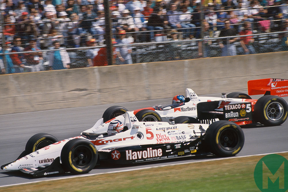 Mansell battles with Emerson Fittipaldi's Penske on the way to his rookie 1993 IndyCar championship