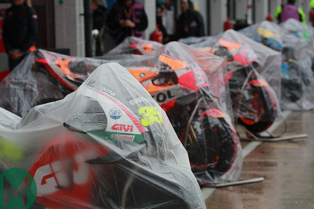 Motorbikes under rain covers at the 2018 MotoGP British Grand Prix at Silverstone