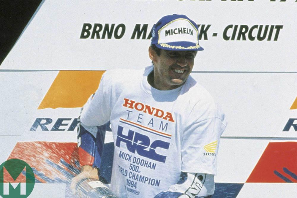 Mick Doohan celebrates winning the MotoGP championship at Brno in 1994